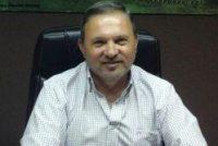El Ministro de Desarrollo Social de la Provincia en Marcos Juàrez entregando tarjetas de débito a beneficiarios planes PILA y PPP